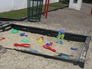 Sandbox with toys to share