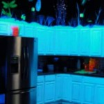 This fully equipped glowing kitchen includes a Keurig and the all important caffeine!