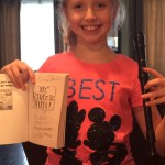 "Emma and her signed copy of ""Mr. Klutz is Nuts"" by Dan Gutman"