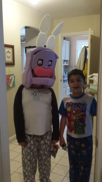 In process pic of my son wearing the withered Bonnie mask. Pink snout is a car sponge